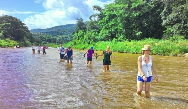 The overnight guests heading back to the park and refreshing by walking in the river