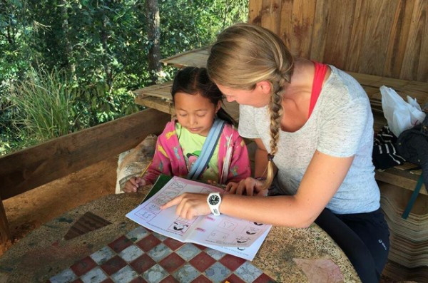 Volunteer at Journey to Freedom teaching English to the hill tribe children